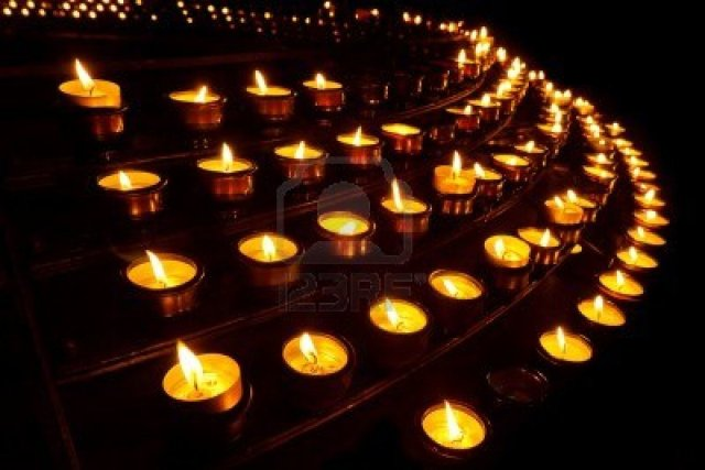 10877856-countless-prayer-candles-at-a-church