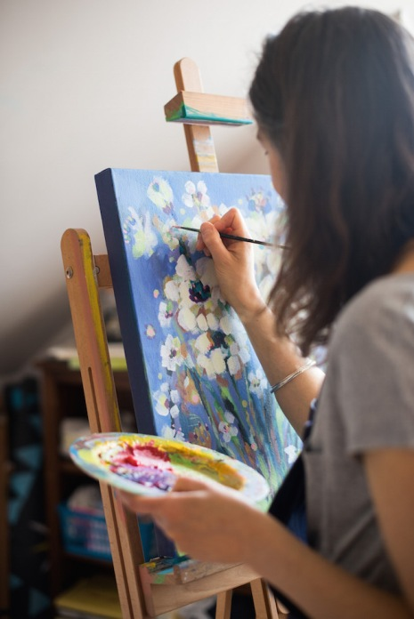 artist-painting-at-easel-flowers-palette-pretty.jpeg